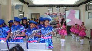 They played  instrument to show welcome to our  visit.